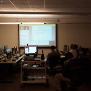 faculty in computer lab watching big screen